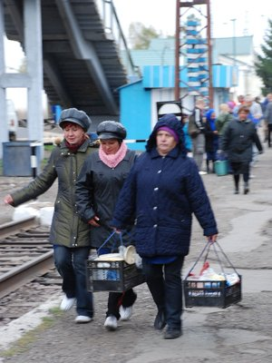 Transsiberian - Women running to sell food