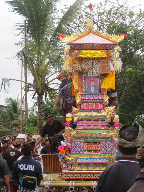 The cremation ceremony getting ready to proceed down the street