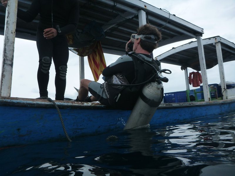 Loic doing a back roll off our dive boat