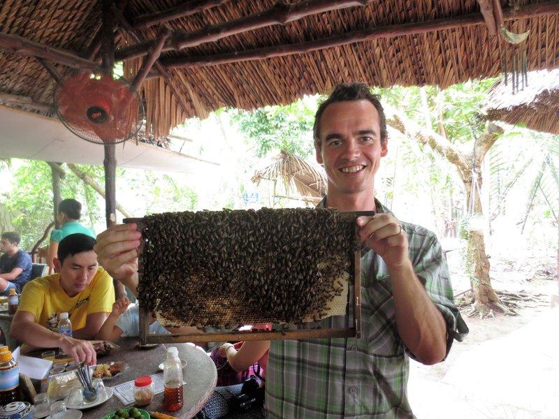 Loic held a beehive