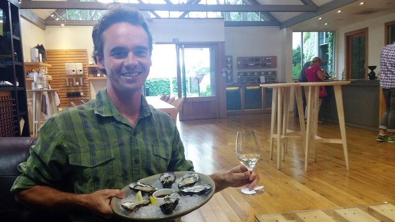 Loic in heaven, at Cloudy Bay winery with great wine, oysters, and soy sauce