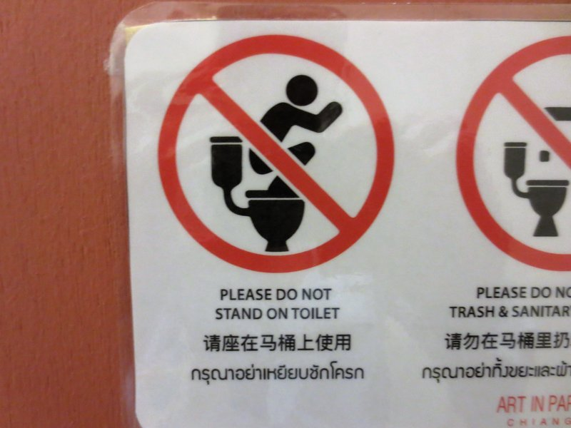 My favorite sign- a squat toilet converting to standard toilet country needs these signs!