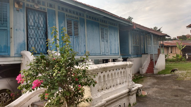 Old Malay stilt home in the agricultural settlement, in the heart of the sky scrapered capital