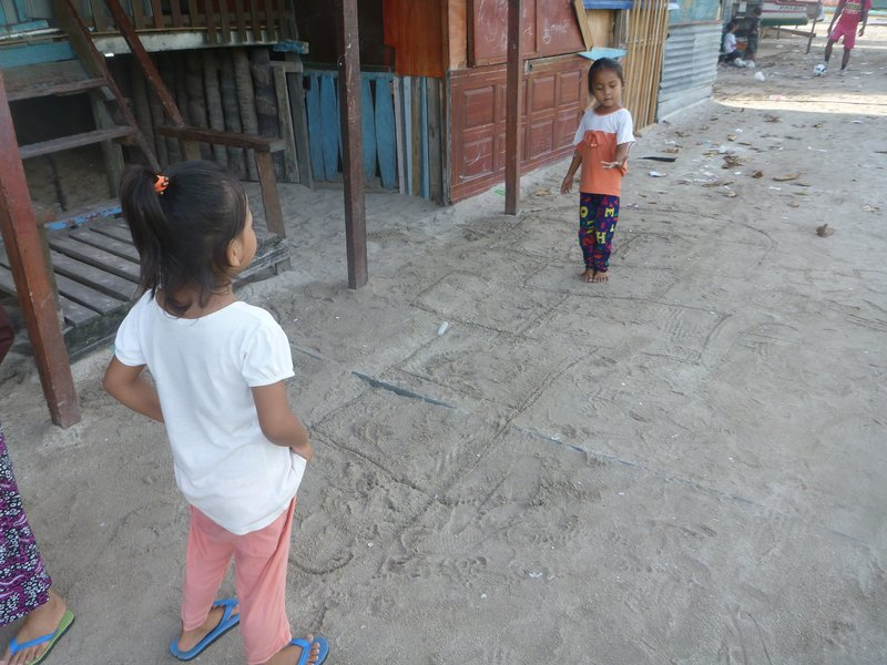 Village girls playing hopscotch