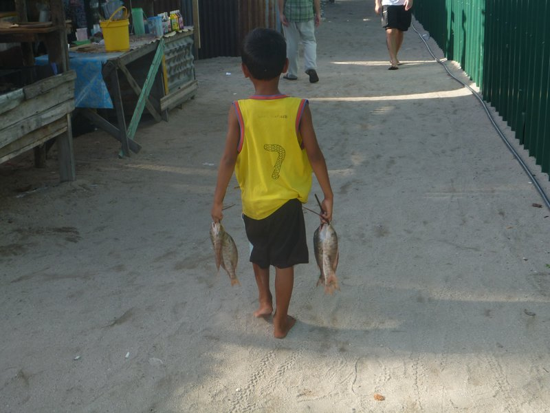 A boy with some fish