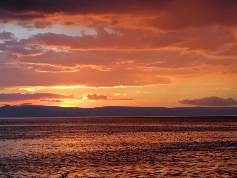 Sunset over Lake Taupo at 5 Mile Bay, a freedom campground