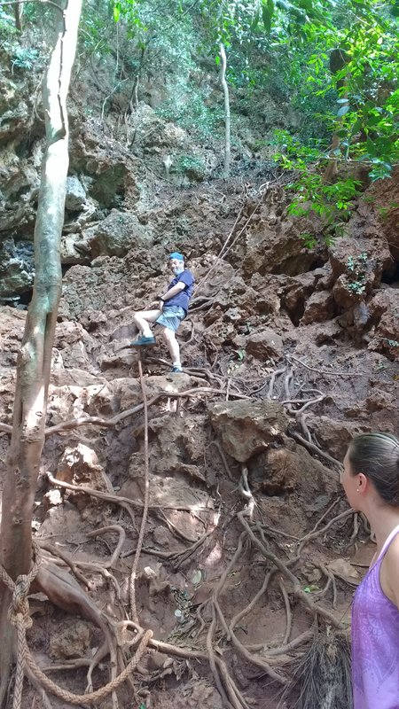 The climb to the lookout was muddy and offered tree roots and a mud-caked rope