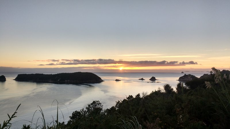 The sunset while freedom camping at Cathedral Cove parking lot