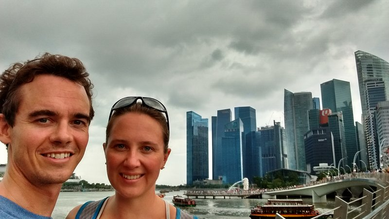 View from the double helix bridge- skyline, river cruise and merlion statue