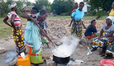 women making ugali for a funeral