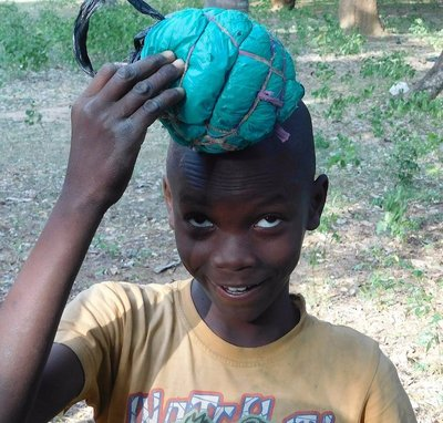 boy with homemade soccar ball