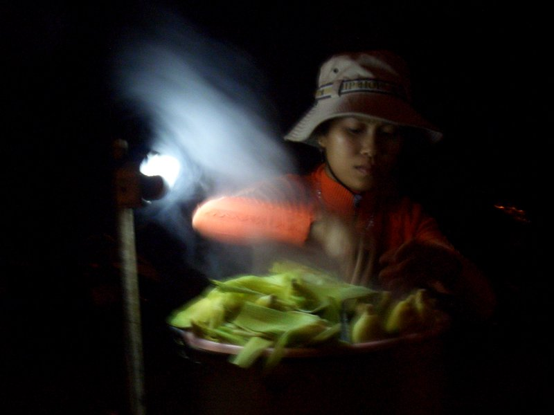 Lady selling Corn