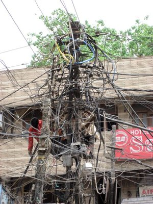 6 Indian men in telephone pole