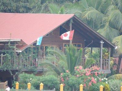 Canada & Guatemala flag at a home in Livingston on the Caribbean Sea