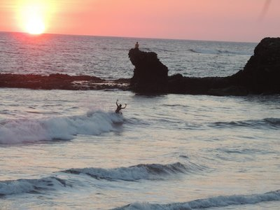 Surfer, meditation and sunset
