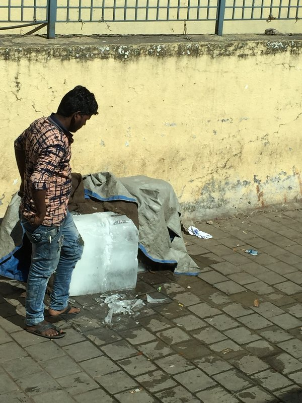Man selling ice on street