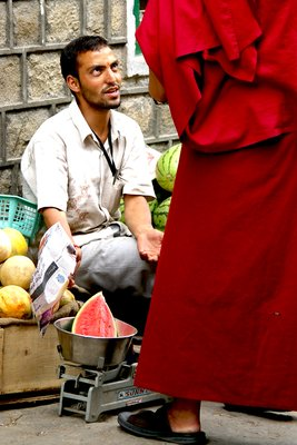 Fruit seller and Monk, India.  Photo by Ardy