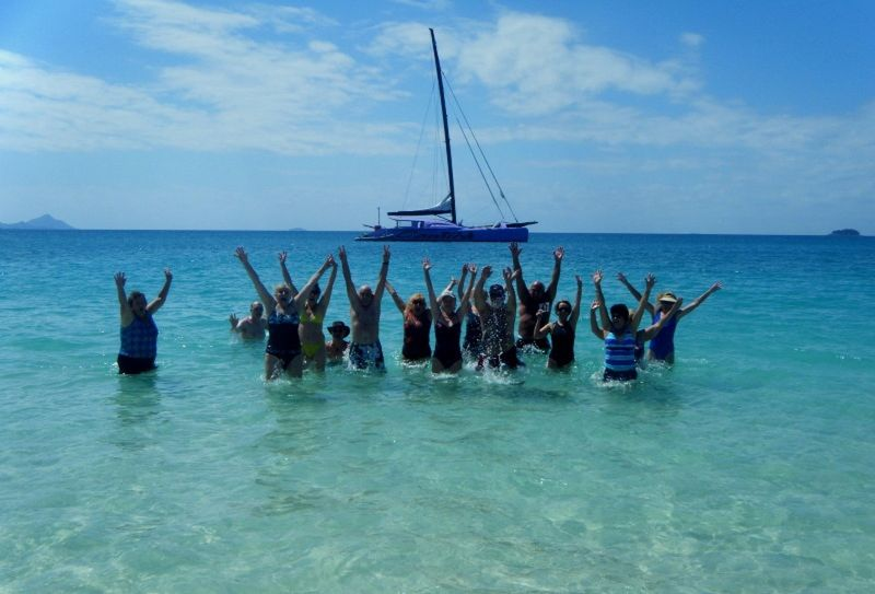 VT'ers Jumping for Norman on Whitehaven Beach - Airlie Beach