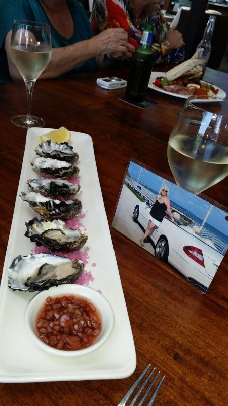 SONG enjoys oysters and SB Wine in Cairns - Cairns