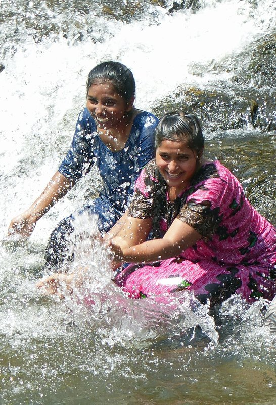 At a waterfall in rural Kerala