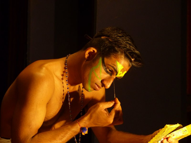 Kathakali dancer applying make-up