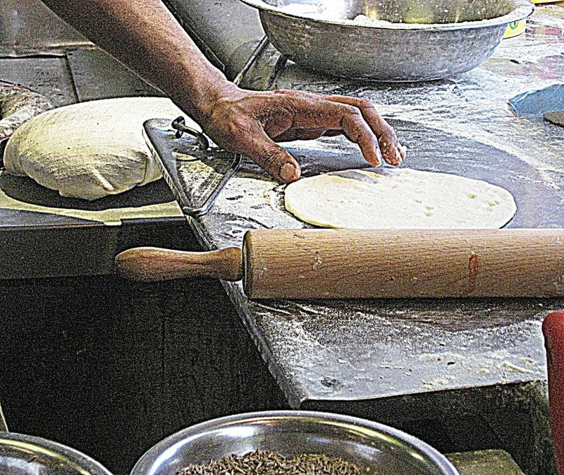 Rolling a roti in Southall