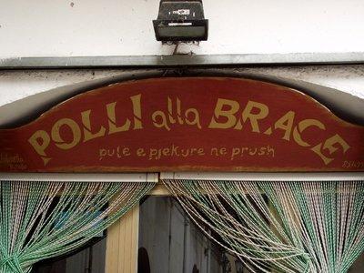 bilingual shop sign