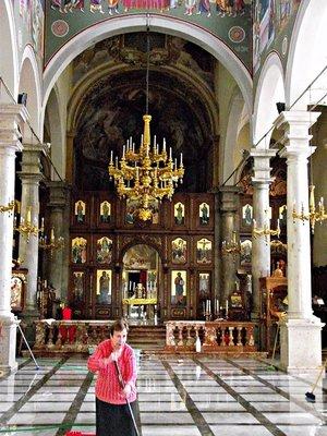 cleaning the cathedral in Piana. NOTE: the iconostasis