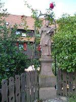 5110065-St_John_Nepomuk_among_roses_Forbach.jpg