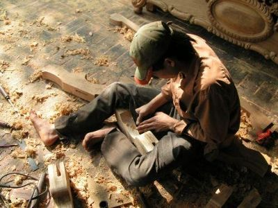 A man carving wood for a bed - Hanoi