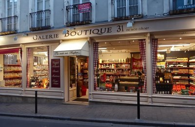 Boutique lit at night in Honfleur