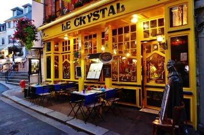 Le Crystal Restaurant lit up at night