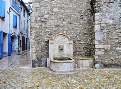 Fountain outside the entrance to the Musée Estrine