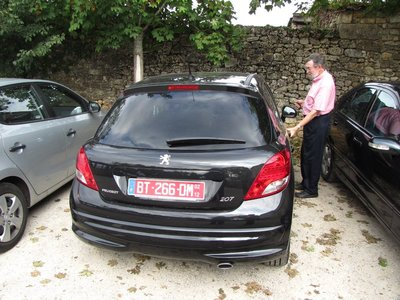 Another leased Peugeot parked in Domme