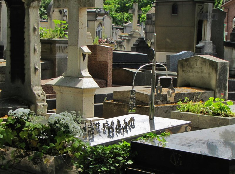 A mobile and the little people in Montparnasse Cemetery in Paris