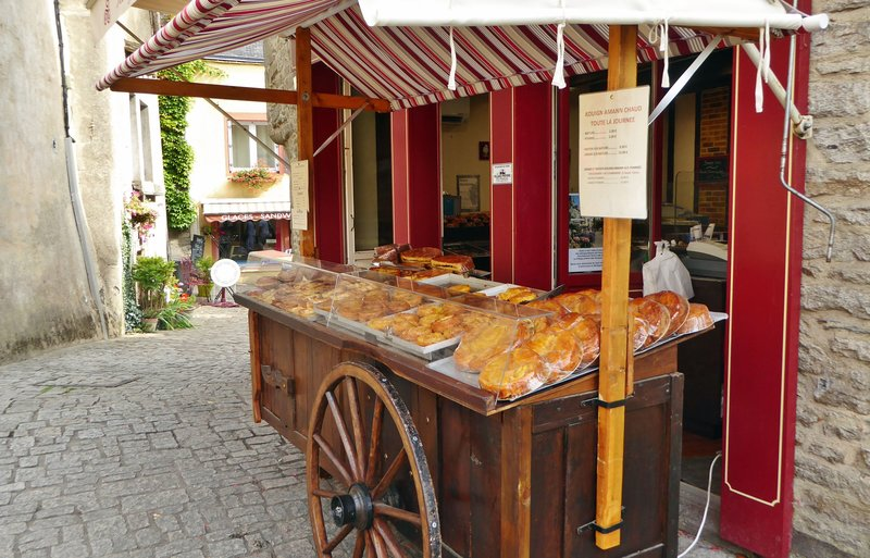 Street stand outside a bakery on the Place du Puits