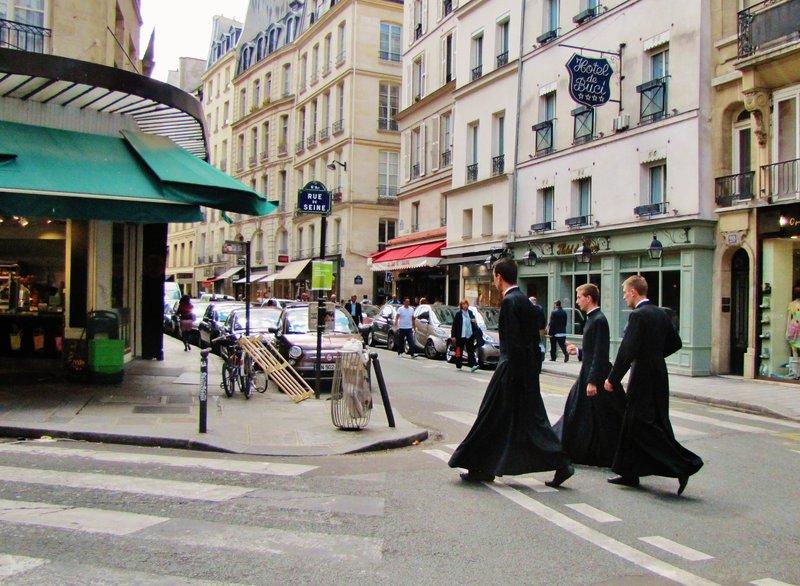 Three seminarians crossing to the Cour des Halles on rue de Seine and rue de Buci