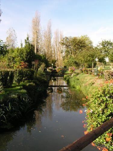 Little canal running through Beuvron-en-Auge