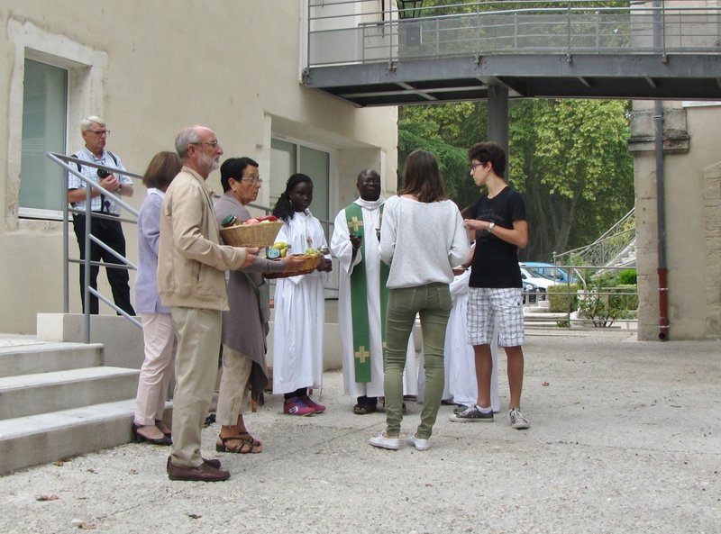 Getting ready for the Harvest Procession, presenting the gifts