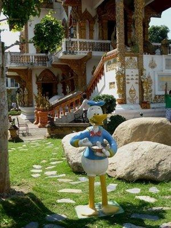donald duck in front of the temple
