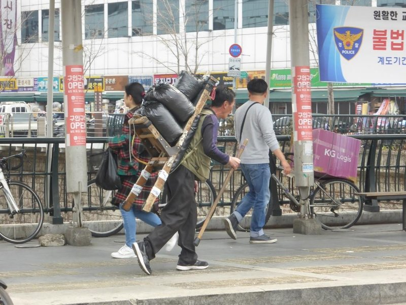 most transport is done with specially adapted motorbikes, but some merchandise is still carried like this
