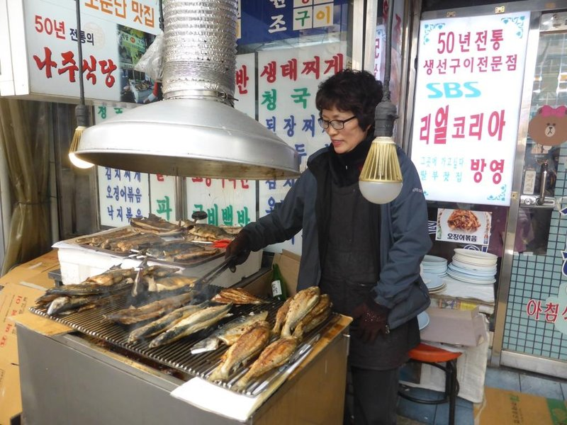 fish is grilled on the street