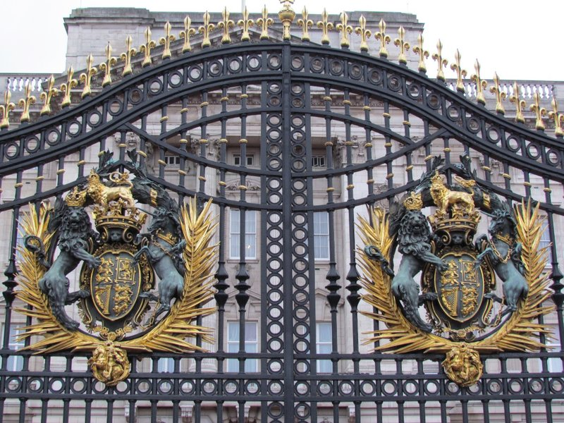 Palace gate with royal coat of arms