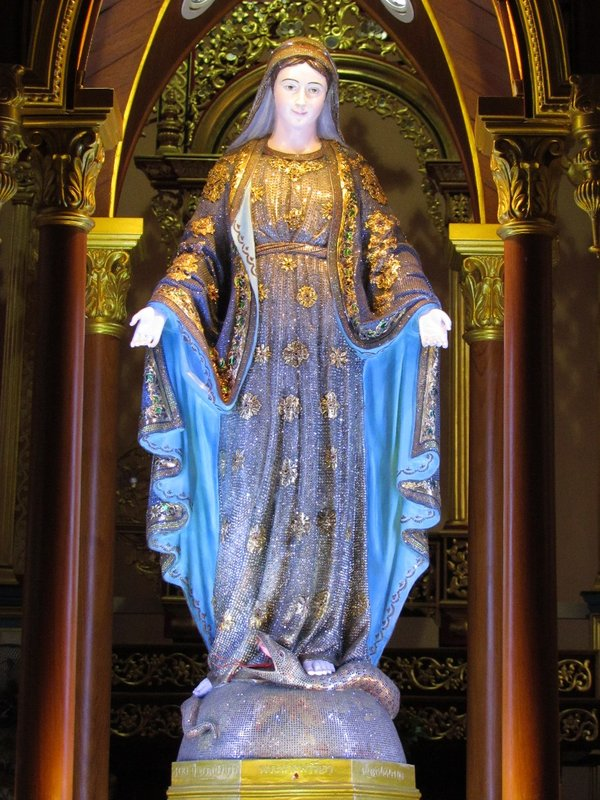 Virgin Mary covered in gemstones