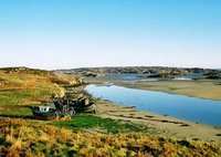 Old boats resting in low-tide at the entrance to Cruit Island, Kincasslagh, Donegal County