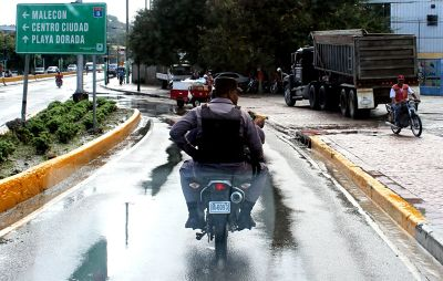 Two on a cycle - M plate (military?) - Puerto Plata