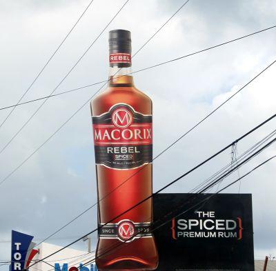 Rum bottle advertisement in the street - Puerto Plata