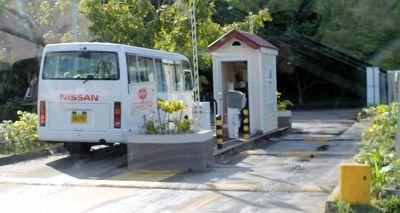 van leaving port area on the left - Grenada