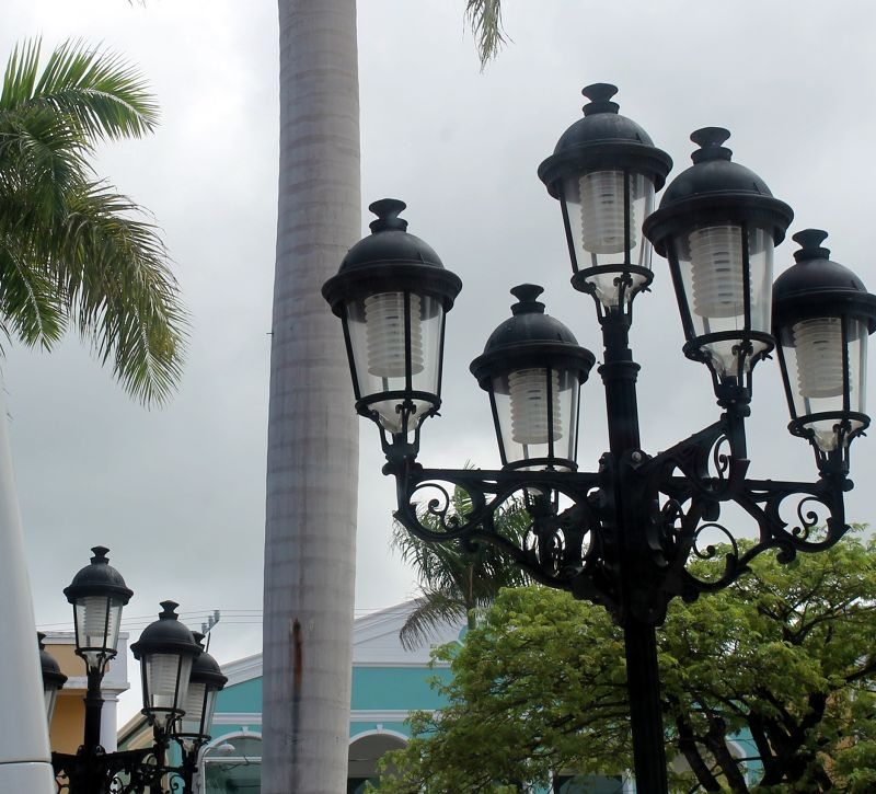 Street lights with pastel building in the back - Puerto Plata