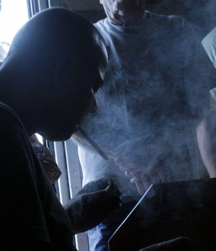Cigar maker smoking a cigar - Puerto Plata